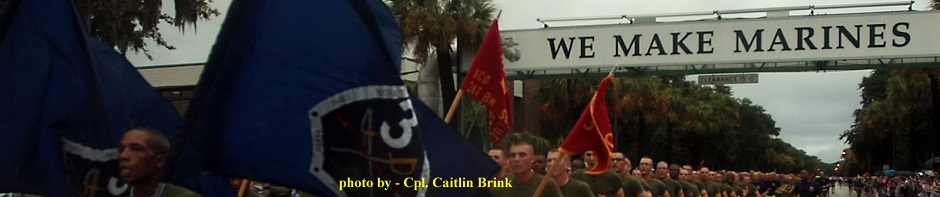 """New Marines of Kilo Company, 3rd Recruit Training Battalion, run under the """"We Make Marines"""" sign during a traditional motivational run through the streets of Parris Island, S.C., on Aug 15, 2013. The run took place before the new Marines had a few hours to reunite with their friends and families for the first time in more than 12 weeks. Kilo Company is scheduled to graduate Aug. 16, 2013. Parris Island has been the site of Marine Corps recruit training since Nov. 1, 1915. Today, approximately 20,000 recruits come to Parris Island annually for the chance to become United States Marines by enduring 13 weeks of rigorous, transformative training. Parris Island is home to entry-level enlisted training for 50 percent of males and 100 percent for females in the Marine Corps. (Photo by Cpl. Caitlin Brink)"""
